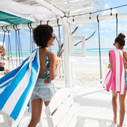 beautiful white cabana on tulum beach with dock and bay microfibre towels in blue and pink