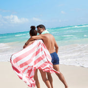 salmon pink towel with stripes for the beach