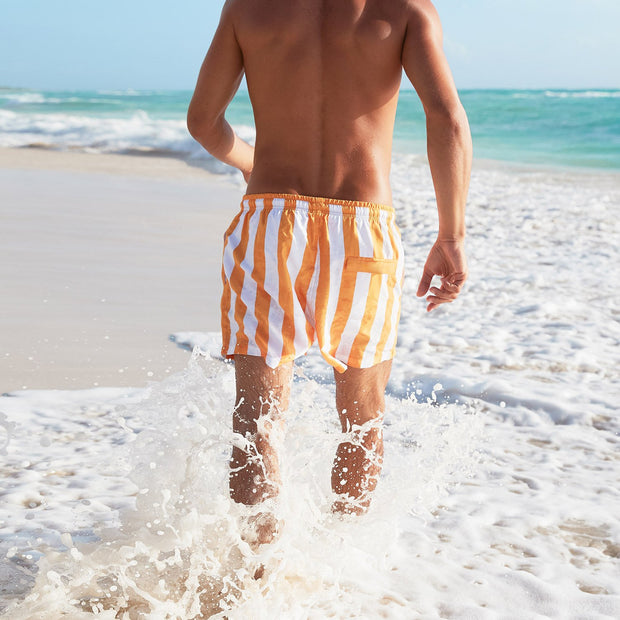 orange swim shorts on mexican beach