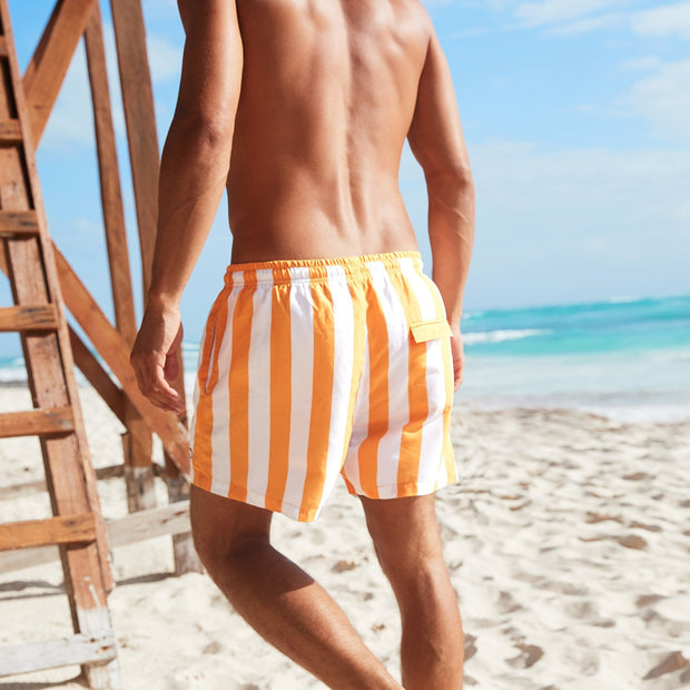 orange striped swim shorts made from recycled materials