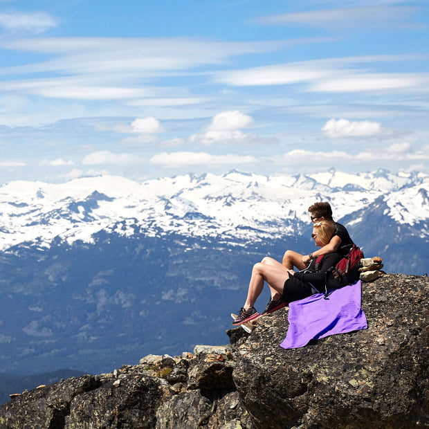 couple hiking with purple microfibre travel towel