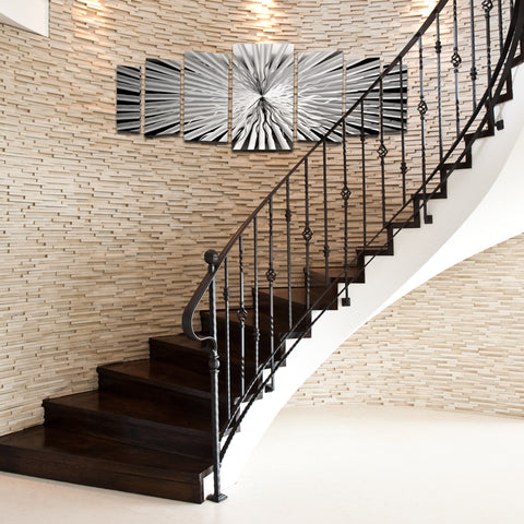 Ideas for wall niches, indentations, staircases, and curved walls - metal art panels and sculptures