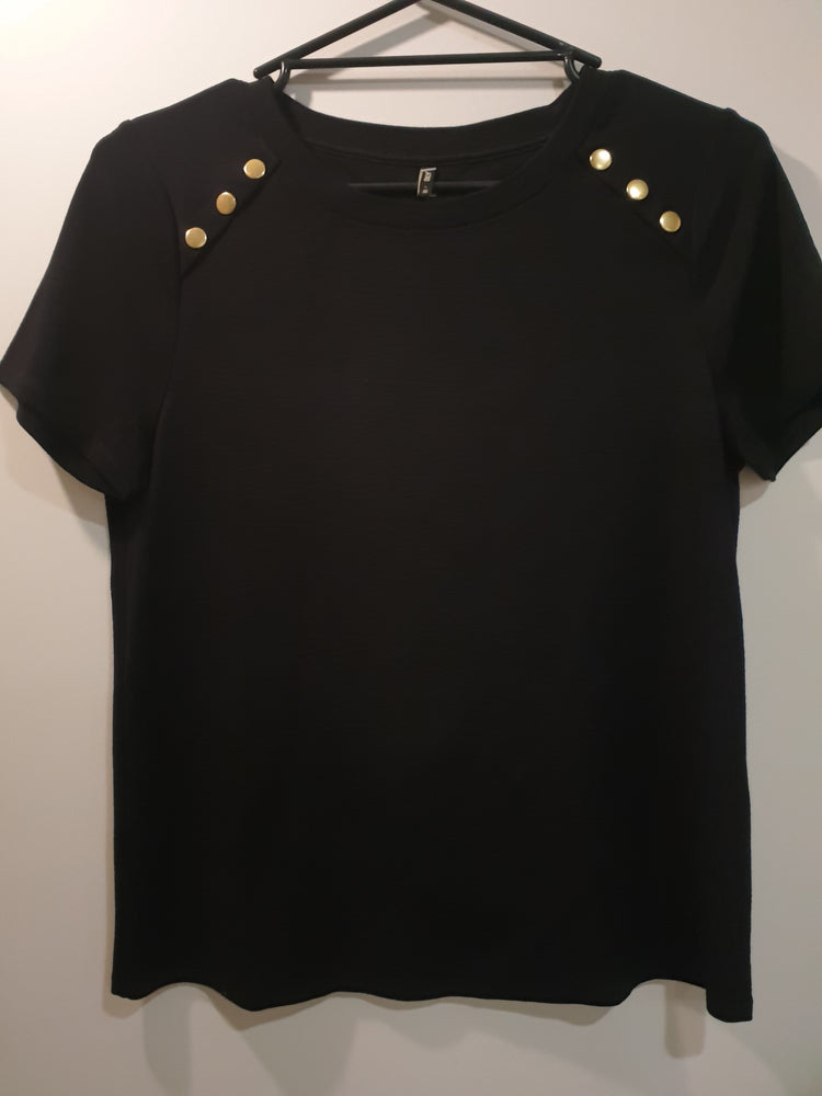 Black top with gold button