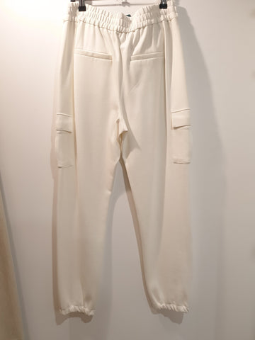 Relaxed tailored white pants with side pockets