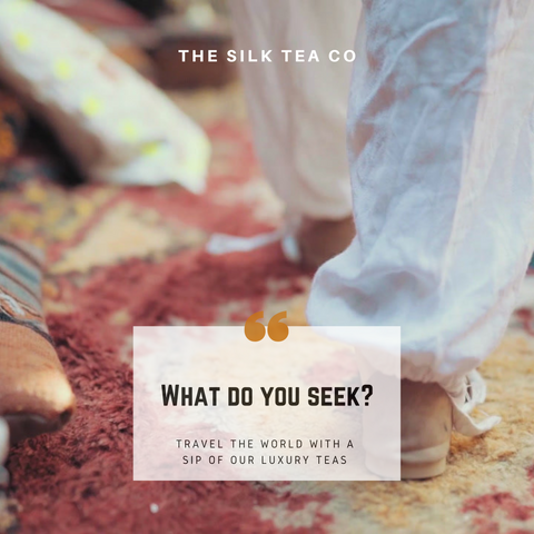 What do you seek? text overlaid on a photo of a woman walking through a Moroccan souk or market, on vibrant rug.