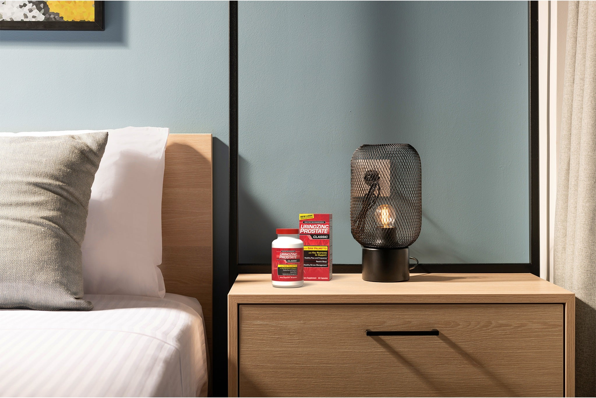 a photo of a bedroom side table with packages of UrinoZinc sitting on it