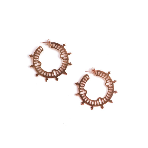Rose gold hoop earrings with edgy details.