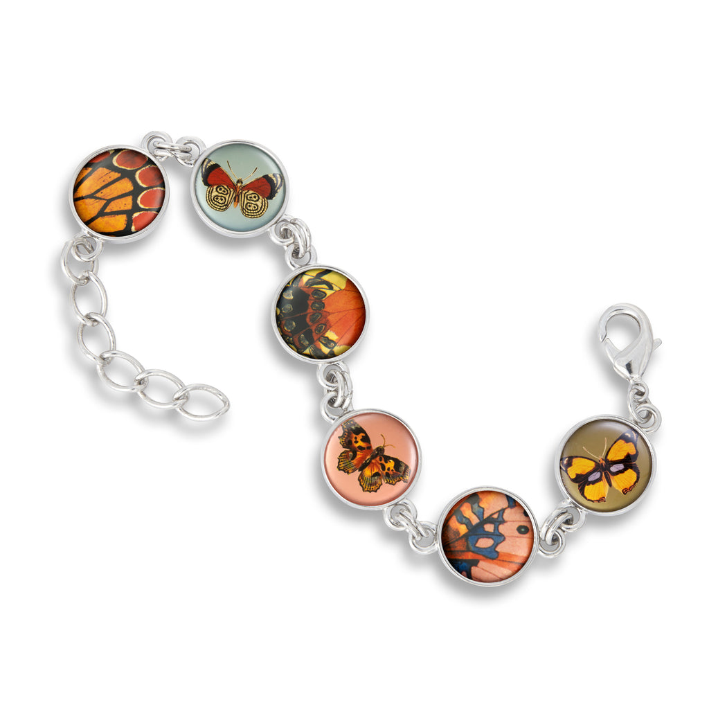 Link Charm Bracelet featuring Butterfly Wings and Kisses