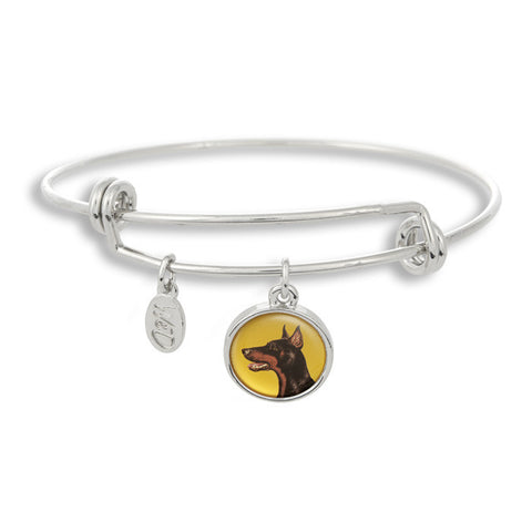 Woof! Keep your dog close to you with The Winky&Dutch Adjustable Band Bangle Bracelet featuring the doberman pinscher.
