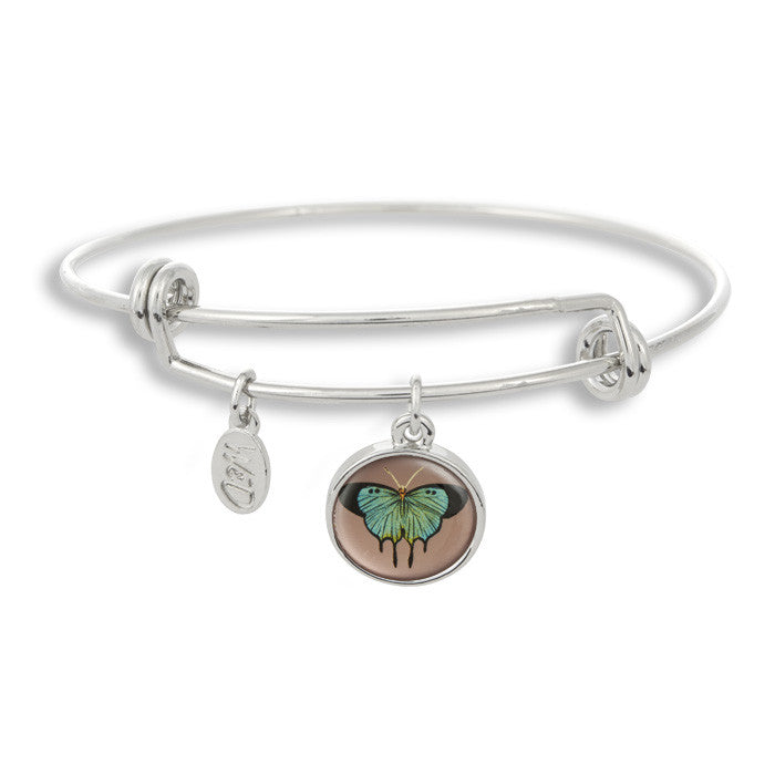 The majestic butterfly is a sure sign of summer and spring! The Adjustable Band Bangle Bracelet features our signature butterfly with a purple background.