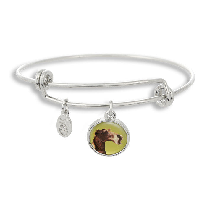 Woof! Keep your dog close to you with The Winky&Dutch Adjustable Band Bangle Bracelet featuring the fox terrier.