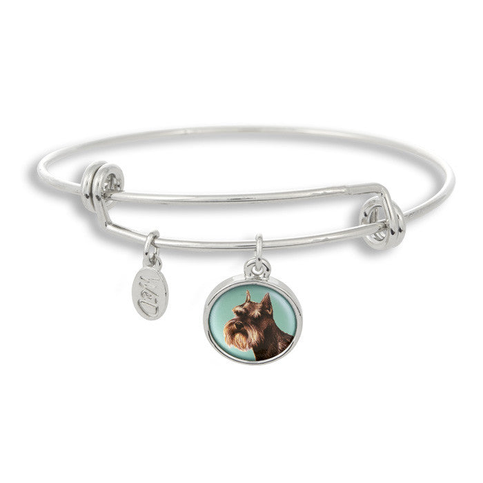 Woof! Keep your dog close to you with The Winky&Dutch Adjustable Band Bangle Bracelet featuring the schnauzer.