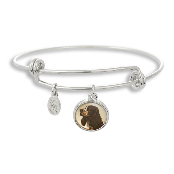 Woof! Keep your dog close to you with The Winky&Dutch Adjustable Band Bangle Bracelet featuring the cocker spaniel.