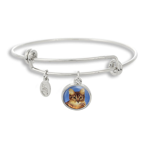 Meow! Keep your cat close to you with The Winky&Dutch Adjustable Band Bangle Bracelet featuring our signature feline with a sharp blue background.