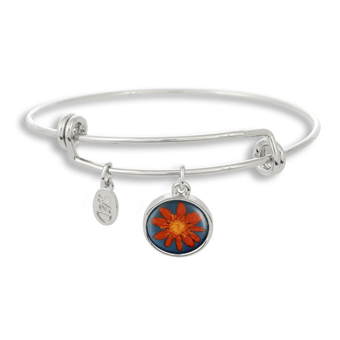 Our orange flower with a bright blue background sits beautifully in The Winky&Dutch Adjustable Band Bangle Bracelet.
