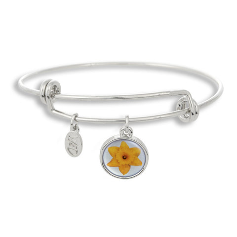 Our yellow flower with a light blue background sits beautifully in The Winky&Dutch Adjustable Band Bangle Bracelet.