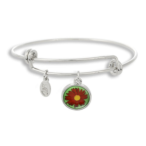 The red and yellow daisy sits beautifully on a teal background on The Winky&Dutch Adjustable Band Bangle Bracelet.