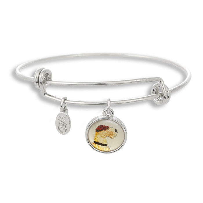 Woof! Keep your dog close to you with The Winky&Dutch Adjustable Band Bangle Bracelet featuring the profile of a painted fox terrier.