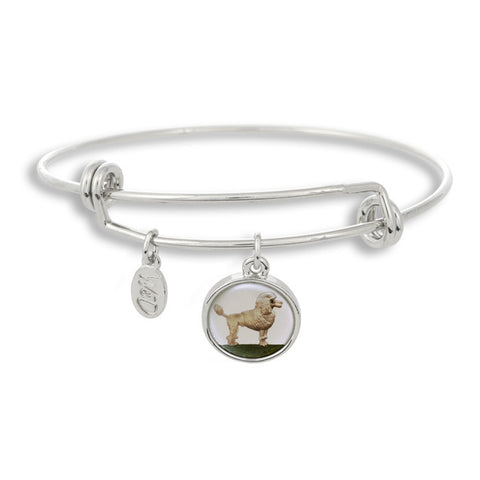 Woof! Keep your dog close to you with The Winky&Dutch Adjustable Band Bangle Bracelet featuring the poodle.