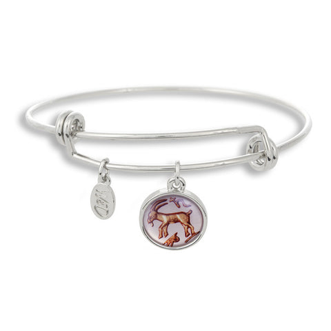 The Adjustable Band Bangle Bracelet featuring the ancient Capricorn astrology sign shows that your style is in the stars!