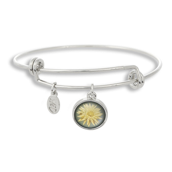 The Winky&Dutch Adjustable Band Bangle Bracelet features a marigold in white, perfect for that summer garden party or to brighten up a dreary day!