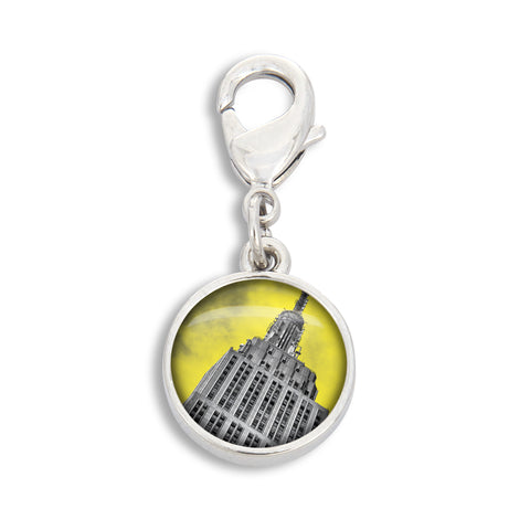 A SilverTone charm with the Empire State Building in black and white with a yellow background