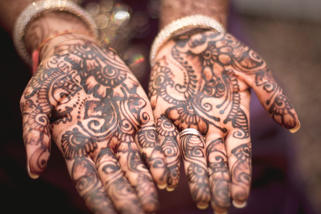 Hands, palms up, covered with Henna Tattoos