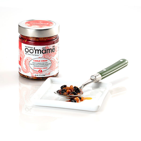 jar of oomame chile crisp with spoon on white saucer