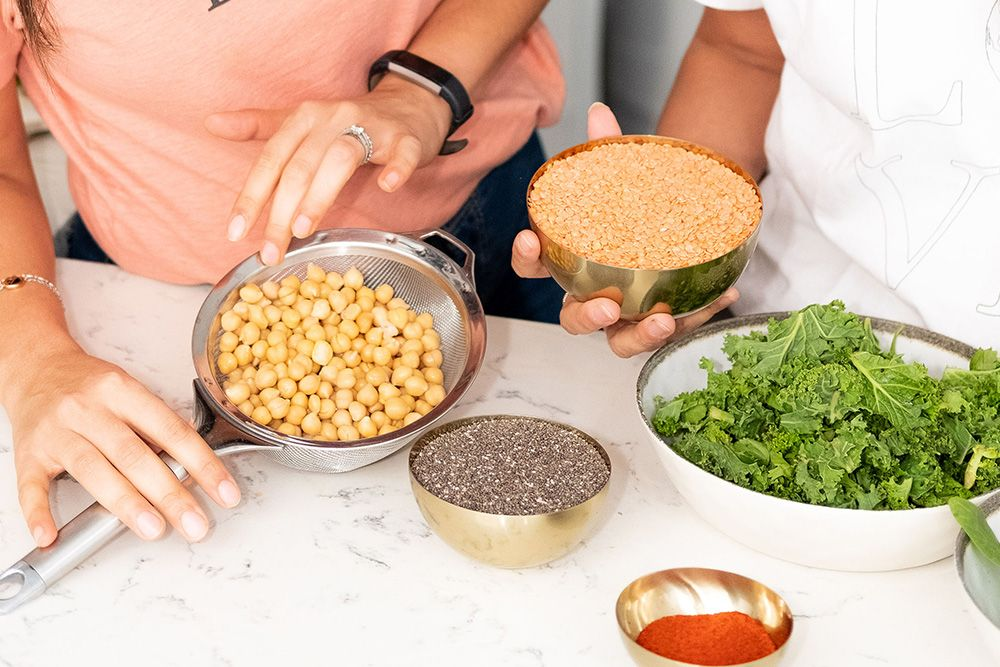 hands over chickpeas in a sieve