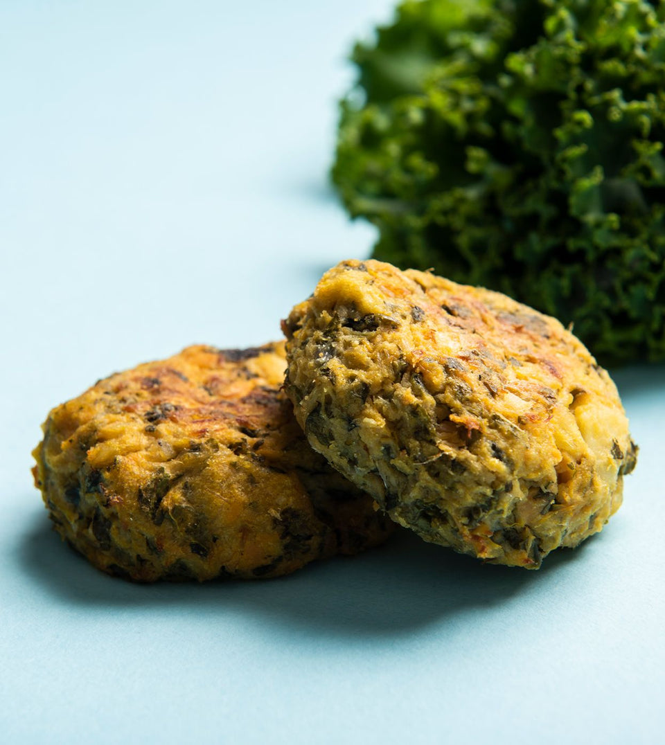 Little Senses Whole Foods kale and coriander fish cakes on blue background