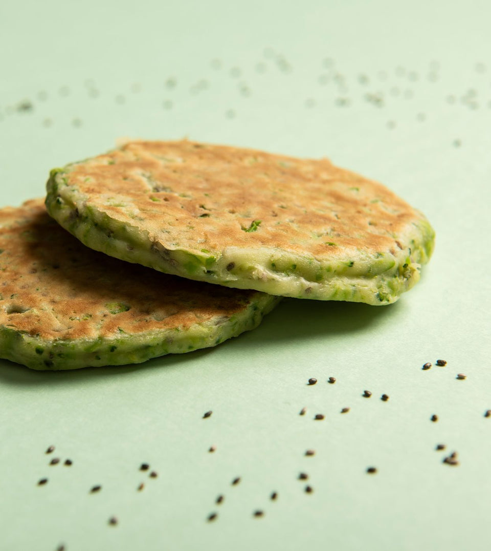 little senses whole foods broccoli and pea pancakes with chia seeds on green background