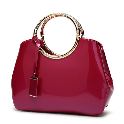 Classic noble shiny leather handbag