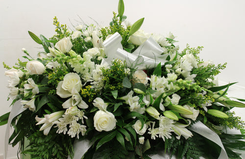 Norma's White Casket Spray Arrangement
