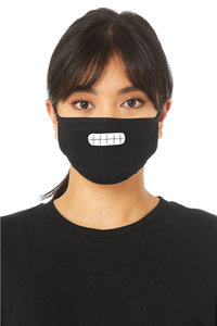 The design on the mask is of a cartoon grin with teeth showing. A person models this black face mask. It covers their nose, mouth, and chin.