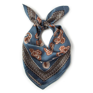 Budapest Kerchief in Cornflower Blue: silky cornflower blue kerchief bandana with amber-colored paisleys and a black border.