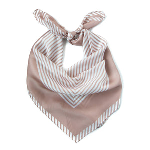 Roma Kerchief in Carnation Pink: a carnation pink kerchief bandana of stripes in the center surrounded by a bold border.