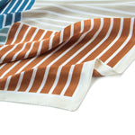 Newport Kerchief in Cerulean: a kerchief bandana with four striped sections of cerulean blue, tiffany blue. gingery orange, and pale gray.