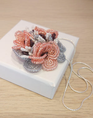 Handmade beaded flower pendant