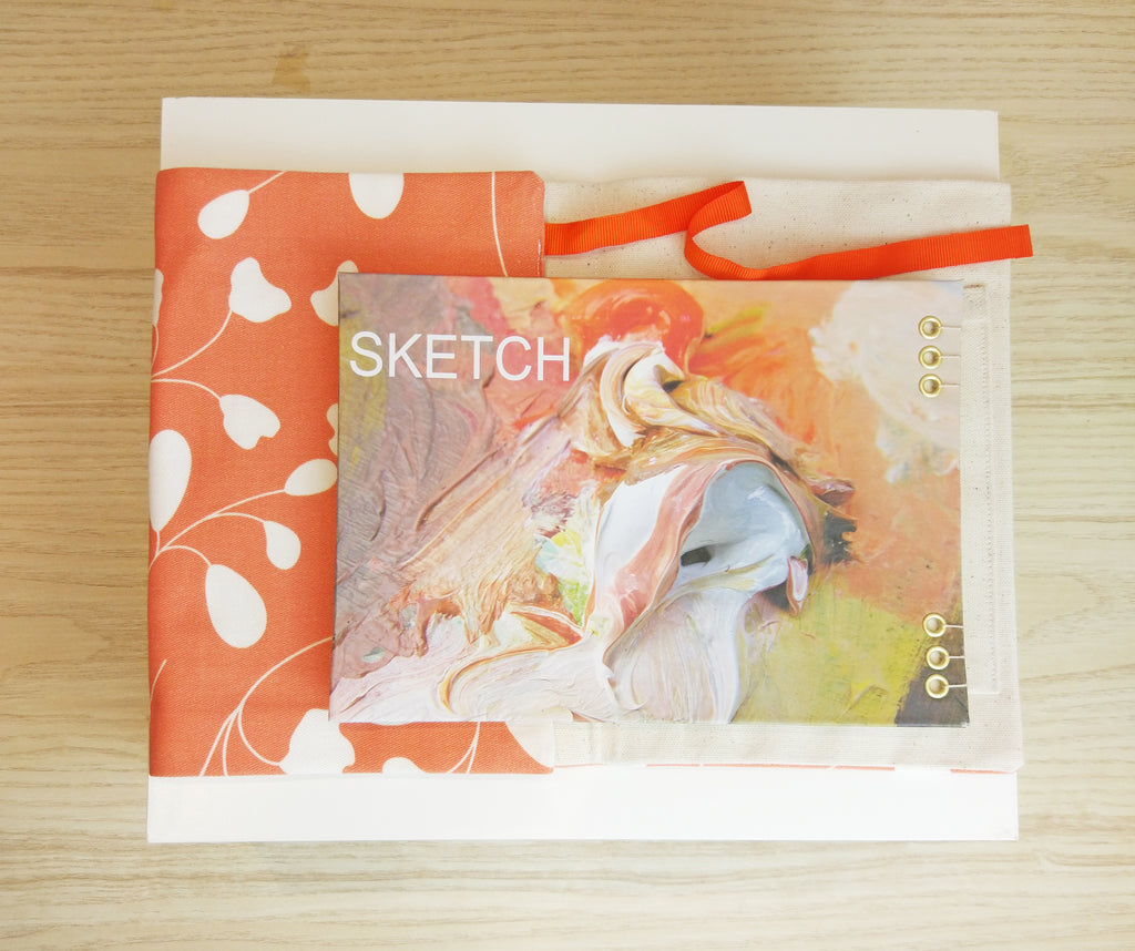 Artist's sketch book and equipment roll