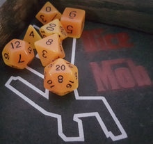 Load image into Gallery viewer, Orange Radiant Glow In The Dark 7pc Dice Set