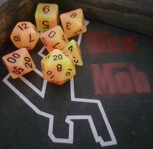 Load image into Gallery viewer, Orange Yellow Double Radiant Glow In The Dark 7pc Dice Set