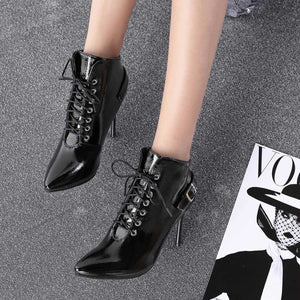 Female lace-tipped short slim-heeled boots