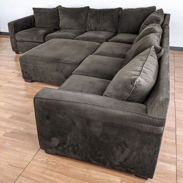 Brown Upholstered Sectional Sofa with Ottoman