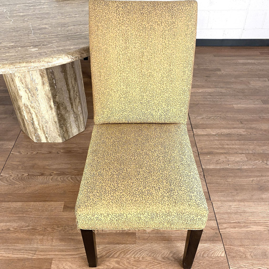 Stone Pedestal Table with Three Upholstered Chairs