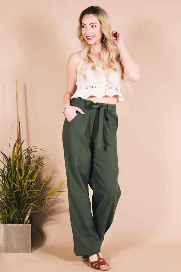 Girl wearing green hippie pants and crop top