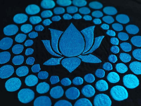 Detail of hand-embroidery on zafu meditation cushion with Lotus design in TURQUOISE. Made in Thailand.