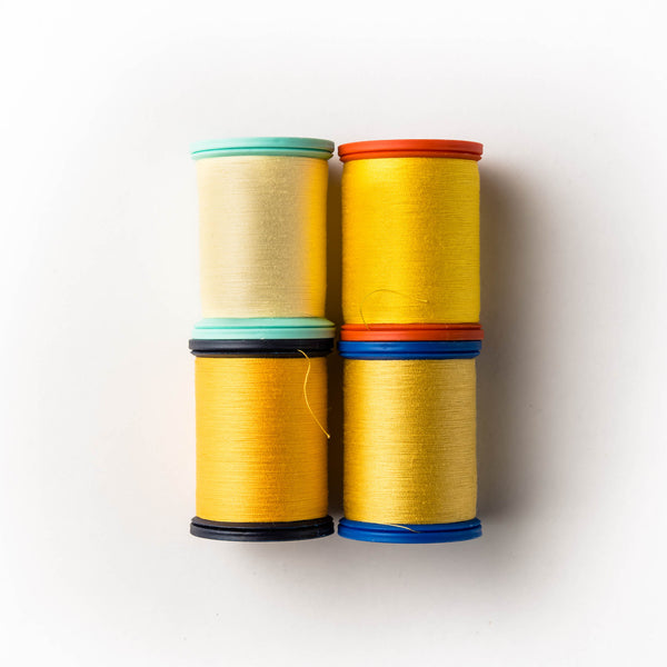 Yellow and sunflower shades of sewing thread