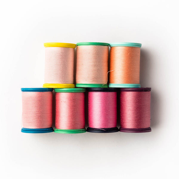 Sewing thread - peach + coral shades