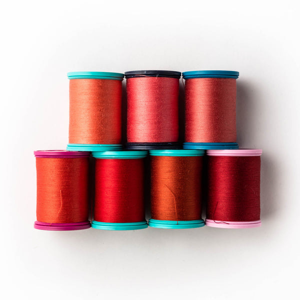 Sewing thread - red + poppy shades