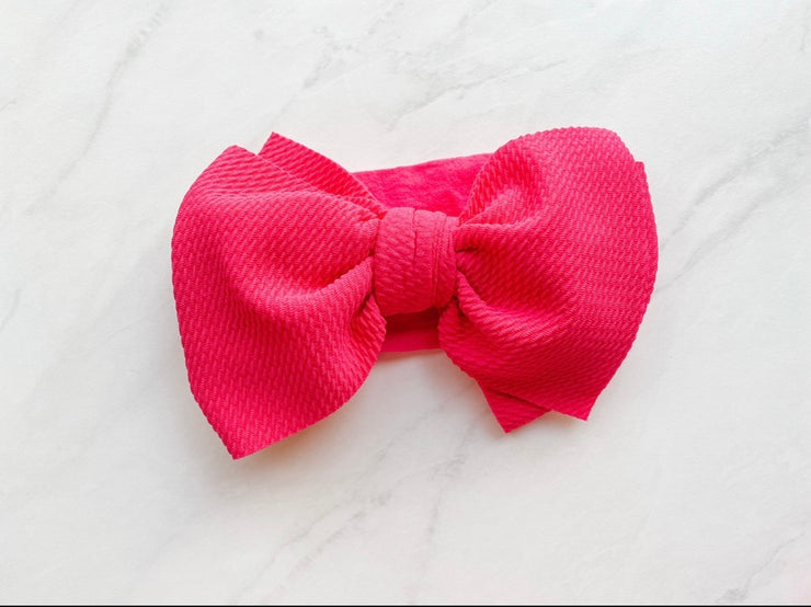 DIVA WAFFLE BOW ON NYLON BAND - DEEP FLAMINGO
